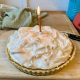 The lemon meringue pie that Charlotte baked for me, with a single lit candle.