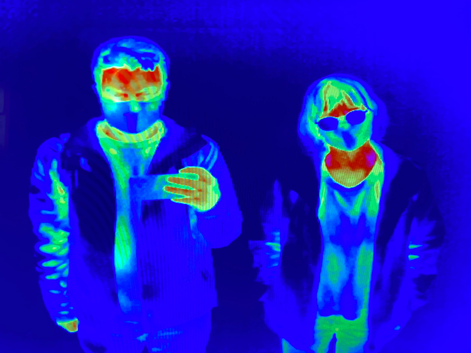 Rowan and Charlotte in blues, greens, and reds. Picture taken by a thermographic camera.