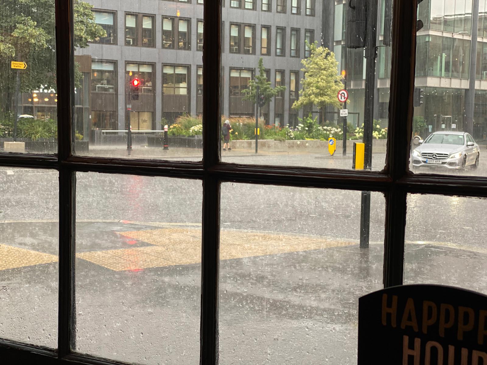 Heavy rain falling on the road outside The Sea Horse.