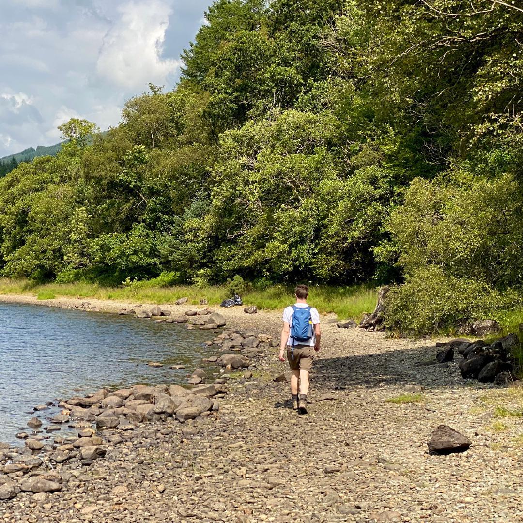 Rowan walking along the rocky shore of Loch Lubnaig