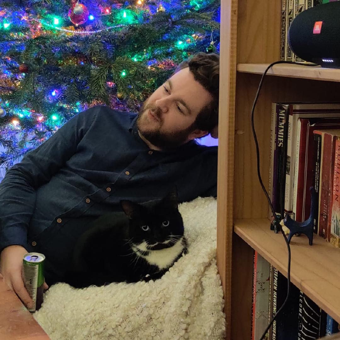 Tootsie and I sharing a beanbag on New Years Eve, with a Christmas tree lighting us