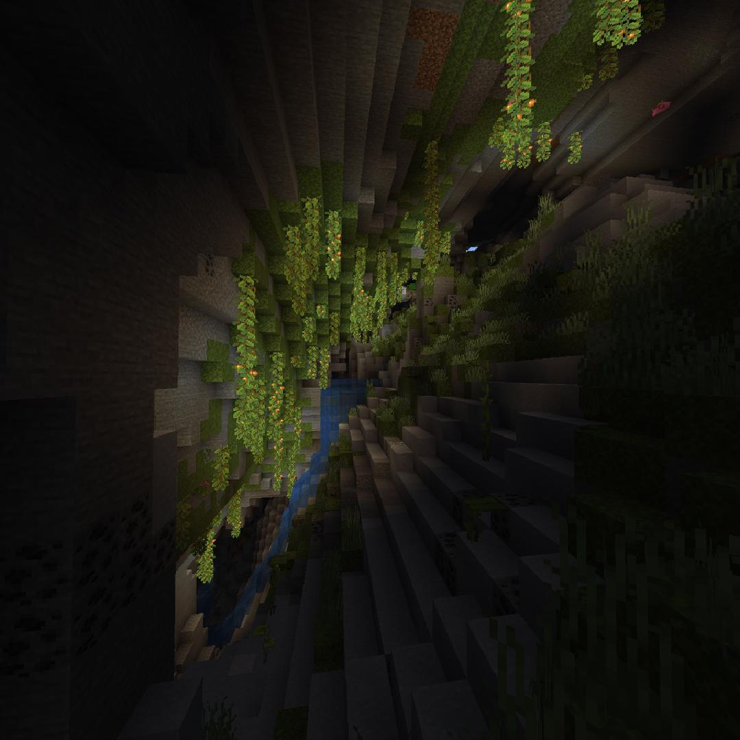 A dark cave with glowing vines descending from the roof