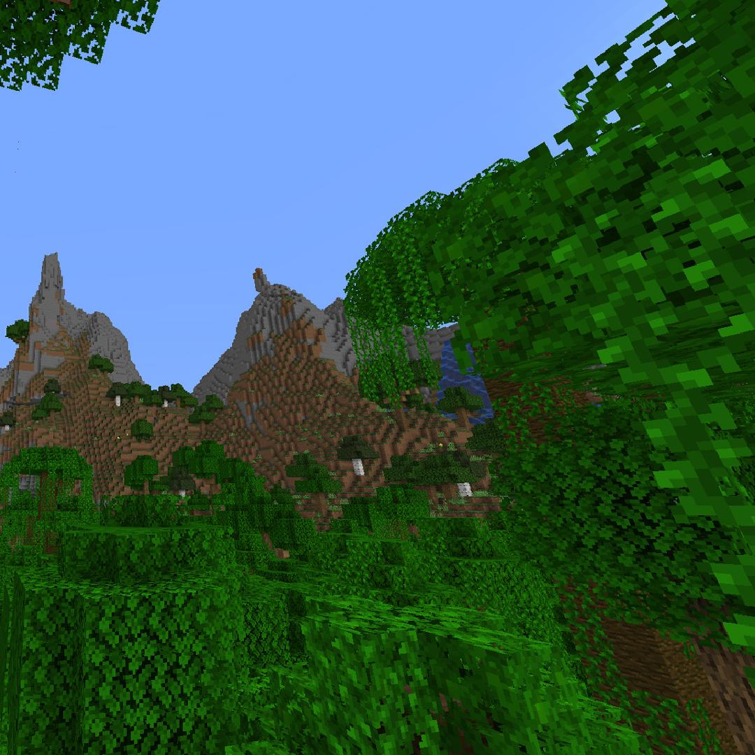 Three mountain peaks poking out of a jungle